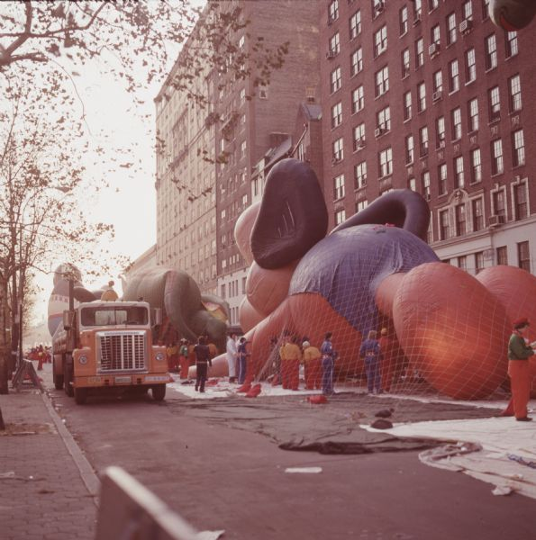 1976 Workers with Parade Float Balloons Under Nets