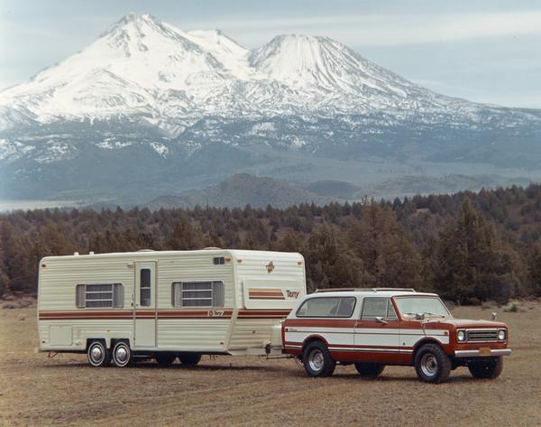 1977 Scout Traveler with Terry Camper in the Mountains