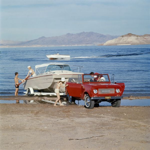 Young Couples Load Boat onto Trailer at Lake from International Scout Pickup