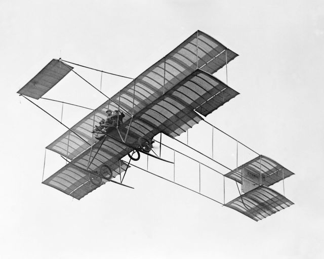 1909 Farman III Louis Paulhan flying with Mrs. Dick Ferris in his Henry Farman biplane, at the Dominguez Field Air Meet, Los Angeles, January 1910(CHS-5602)