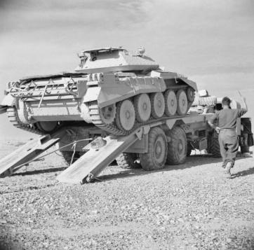 1941 A Crusader tank being put on a scammell transporter ready to be taken back to the forward areas after receiving repair work at a tank repair depot