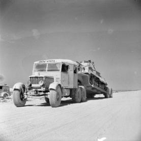 1941 Scammell tank transporter named 'Snow White' carrying an A9 Cruiser tank to the workshops for an overhaul in the Western Desert