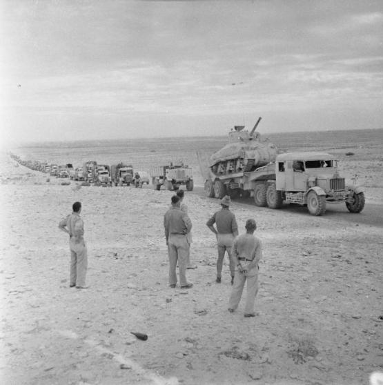 1942 A long line of transport, including a Sherman tank on a Scammell tank transporter, moving along the coast road in pursuit of the enemy