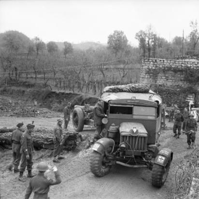 1943 7.2-inch gun and Scammell tractor of 18-56th Heavy Regiment, Royal Artillery, negotiating a narrow corner in the 46th Division sector, 23 December 1943