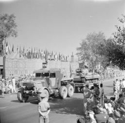 1943 Scammell tank transporter carrying a repaired Valentine tank forms part of the United Nations parade in Cairo which saw 5,000 troops and vehicles pass through the city, 14 June 1943