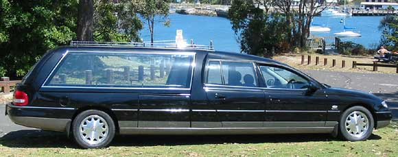Statesman hearse with raised roof. Side opening glass. Caprice front and rear
