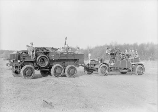 AEC 850 6 x 6 artillery tractor of 15 AA Battery towing a 3-inch AA gun on the cruciform travelling platform.