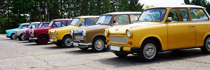 Several Trabant cars of different models in a line